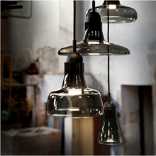 Classic industrial pendant combines sleekly shaped hand blown crystal glass