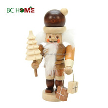 exquisitely crafted santa claus wooden Nutcracker with brown tree