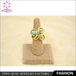 2015 yiwu new products gold plated ring with rhinestone and green plastic beads