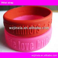 2015 rubber band bracelet maker, hot selling engraved logo silicone bracelet
