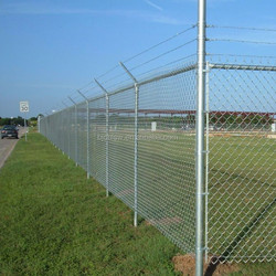 High security chain link fence top barbed wire