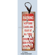 """""""KEEP GUNS LOADED AND READY AT ALL TIMES, ZOMBIES HAVE BEEN SPOTTED AT THIS AREA"""" PAPER PRINTED CUSTOM METAL BOOKMARK"""