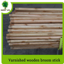 Varnish and painted wooden broom stick