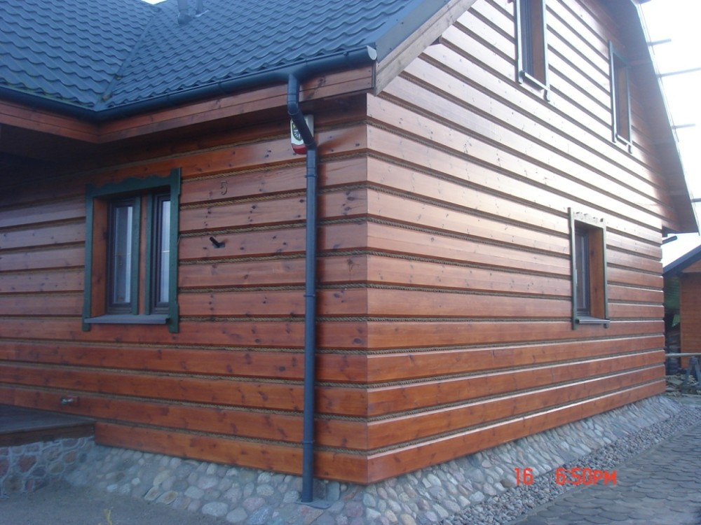 Wooden facade panels pine siding logs exterior siding for Exterior wall covering materials